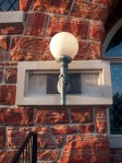 Hand holding lamp on library, Defiance, OH